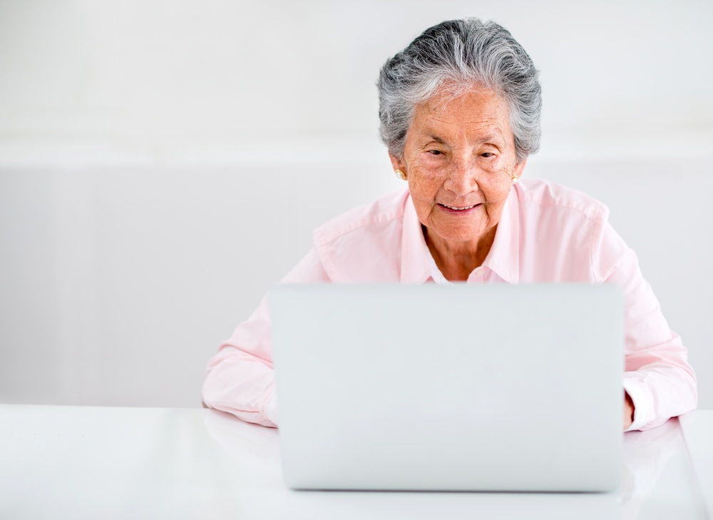 Elder woman using a laptop computer at home